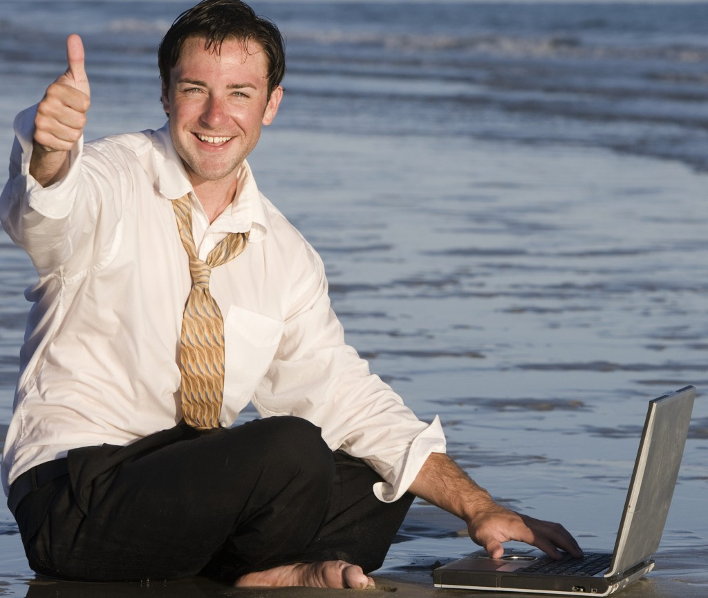 work anywhere, work from the beach, cheesy stock photo